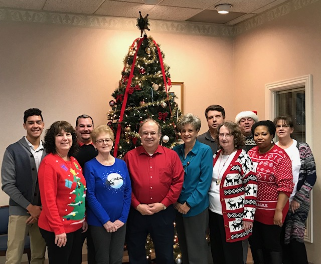 Your credit union staff in front of the tree. Merry CHRISTMAS and Happy Holidays!