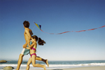 Image of a daughter and father flying a kite