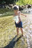image of a boy in a stream