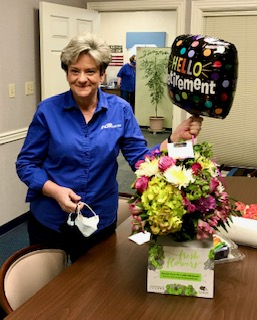 Picture is of Judy holding her Rretirement balloon her last day Feb. 5th 2021