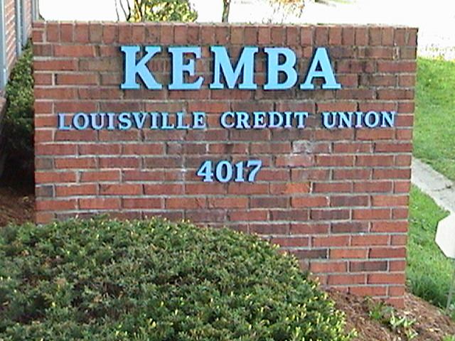Picture of the KEMBA Louisville Credit Union name on the brick wall sign.