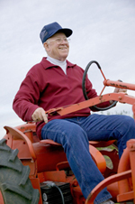 Traditional IRA - man on a tractor
